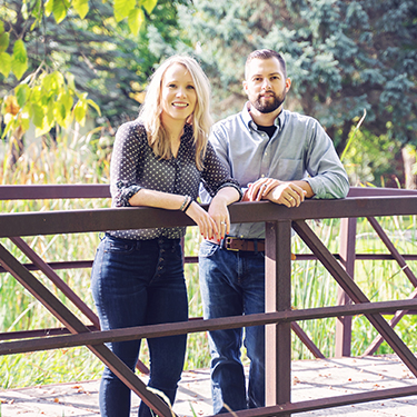 Dr. Brielle Egilson & Dr. Nick Lee standing near Enlighten Chiropractic in Lakeville MN